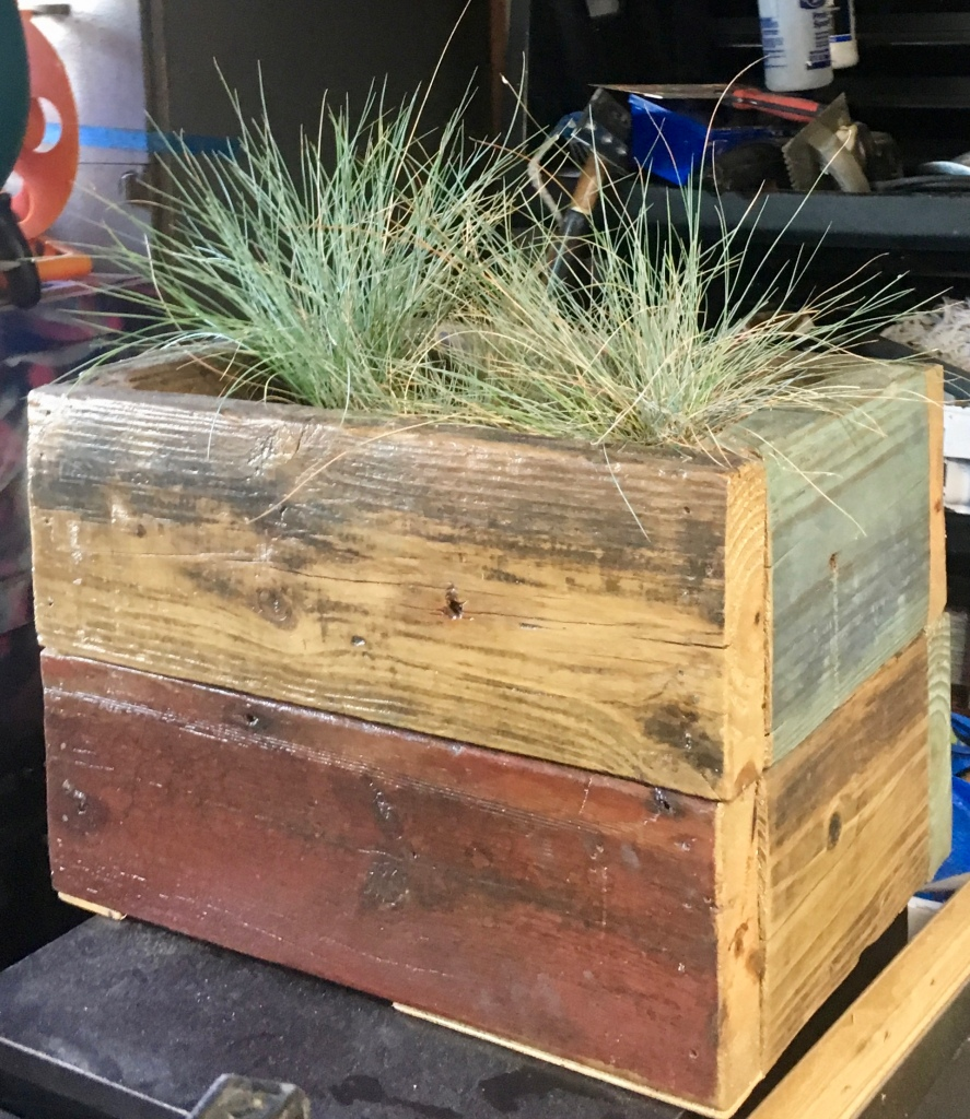Reclaimed Dock wood made into a planter. the wood was already stained, so I put a couple layers of protective brown wax over the entire planter for a uniformed finish, plus a clear coat that can withstand the water and soil.