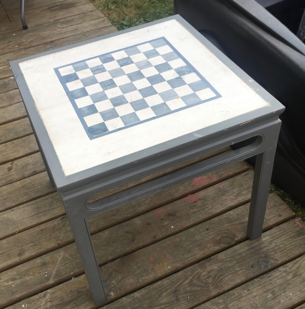 Trash picked up cycled checkerboard table
